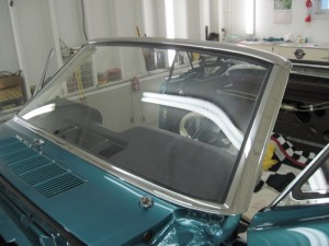 The windshield trim has been polished and reinstalled.