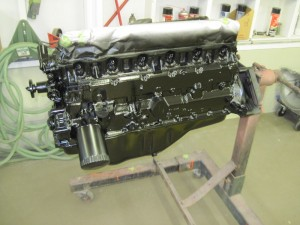 The engine has been painted for the 1965 Mustang with the correct black color and sheen.