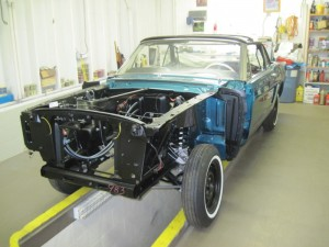 The front suspension has been reinstalled in our 1965 Twilight Turquoise Mustang