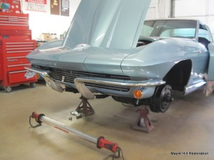 Installing the front bumpers on the 1964 Corvette