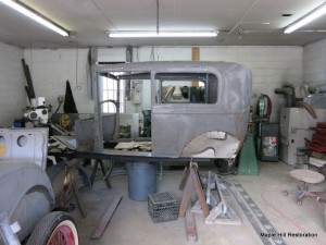 Model A Ford undergoing sheet metal repairs