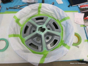 The wheels have been fully masked and are ready for the black to be sprayed on the centers