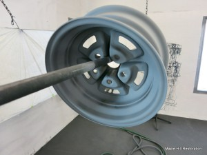 The black overspray from painting the front side was allowed to come thru on the backside of the wheel just as the manufacturer would have sprayed it
