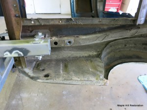 The left rear trunk floor is ready to have the undercoating removed from it