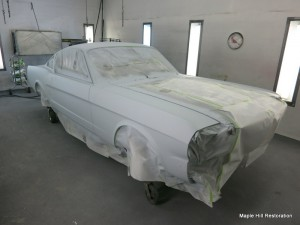 Once the body work was completed, 3 coats of polyester primer was applied