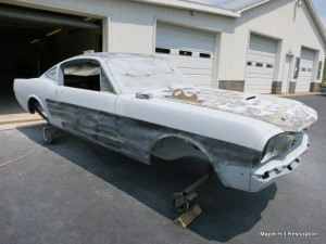 Block sanding the primer on the 1966 Shelby GT350